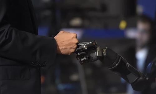 A fist bump between a human and a robot.